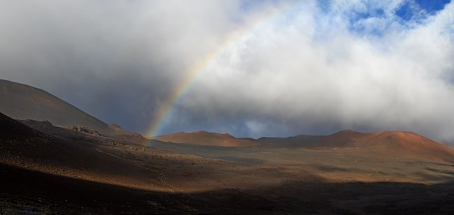 A rainbow appears in the crater.