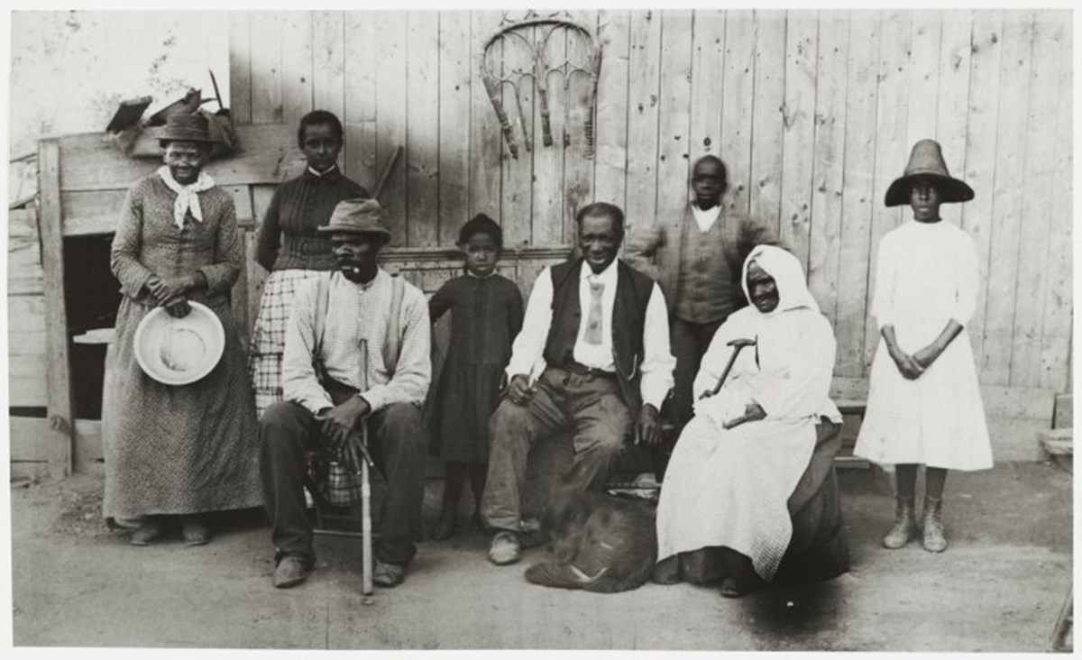 Black and white photograph of Tubman standing with her family.