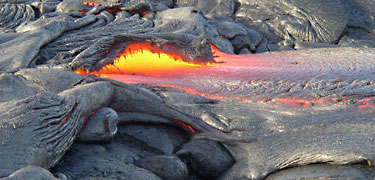 Lava flows like a river out of a hardened crust. NPS photo by Katja Chudoba.