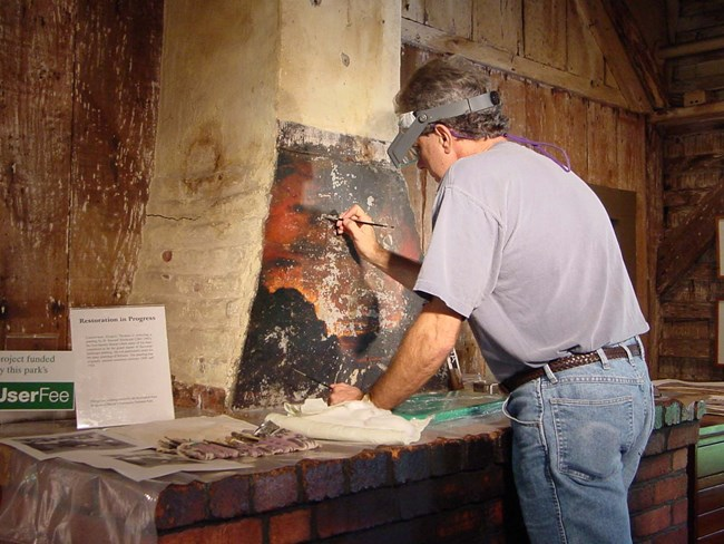 art conservator working in situ