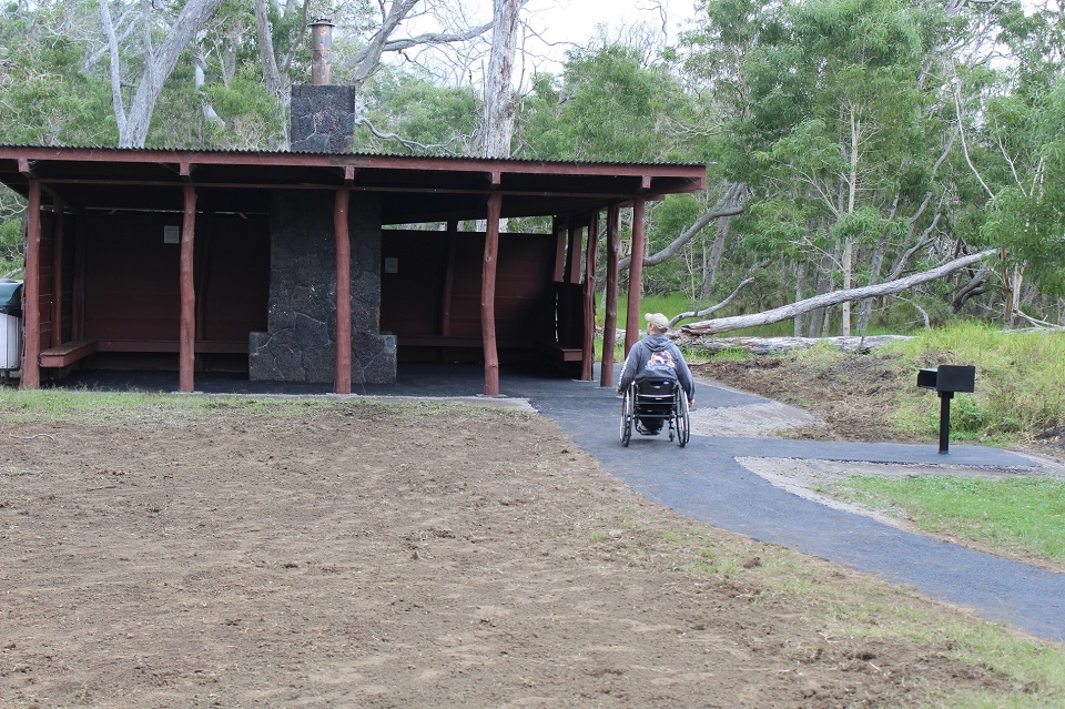 Man in wheelchair at picnic area
