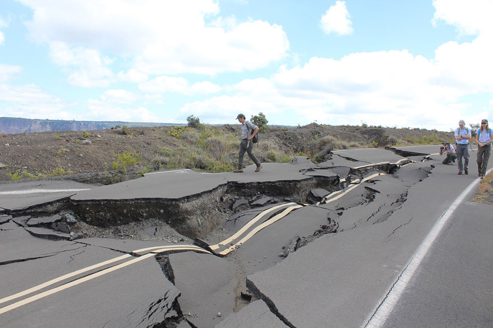 Park staff survey 2018 earthquake damage on the south side of Crater Rim Drive