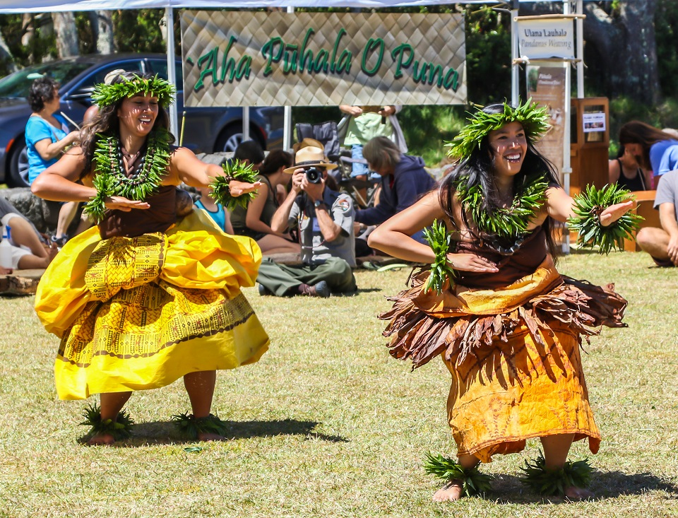 Two hula dancers perform