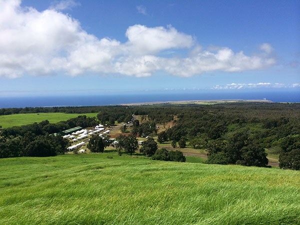 A sweeping view of Kahuku, looking down on the 2014 cultural festival, and the coast from the top of Pu'u Lokuana cindercone