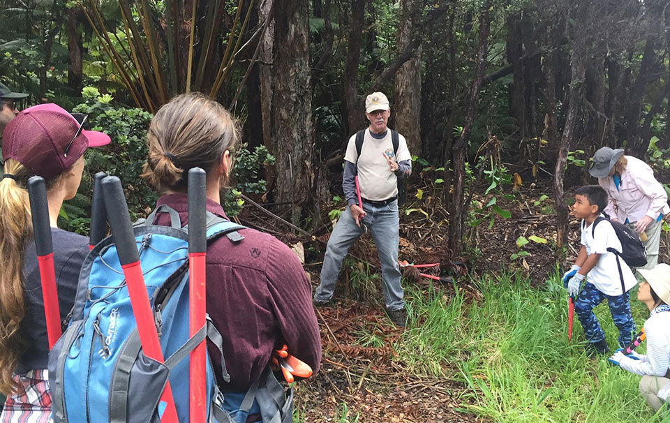 Paul Field instructs volunteers on vegetation management