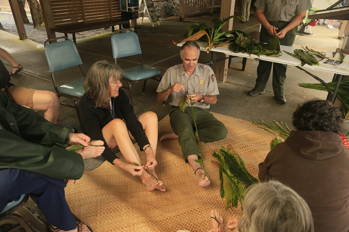 Ranger Dean demonstrating ti leaf lei-making