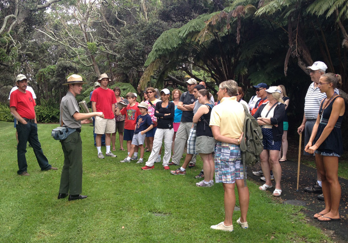 Ranger Travis and visitors explore the summit rainforest on Kīlauea volcano