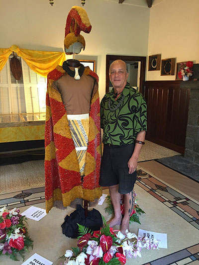 Master feather artist Rick San Nicolas with his feathered cape and cloak