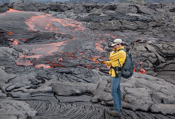Hawaiian Volcano Observatory geologist mapping a lava flow in 2012