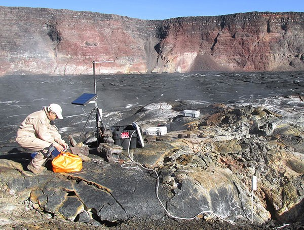 Hawaiian Volcano Observatory scientist monitoring gas emissions on Mauna Loa in 2015