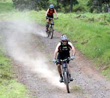Mountain bike riders kick up alot of dust on the downhill