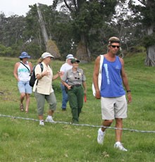 Park Ranger Ruth Levin leads visitors on a hike through Kahuku
