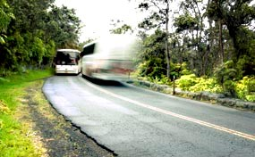 Two busses pass each other on Crater Rim Drive