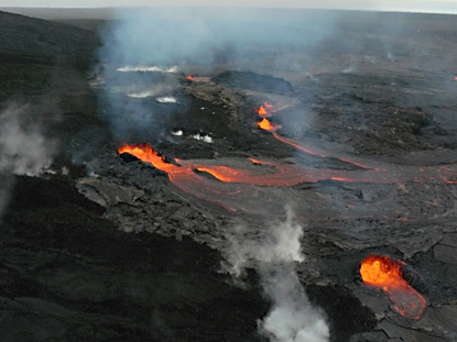 Early morning view of lava flowing out of the west flank vents on Puu Oo.