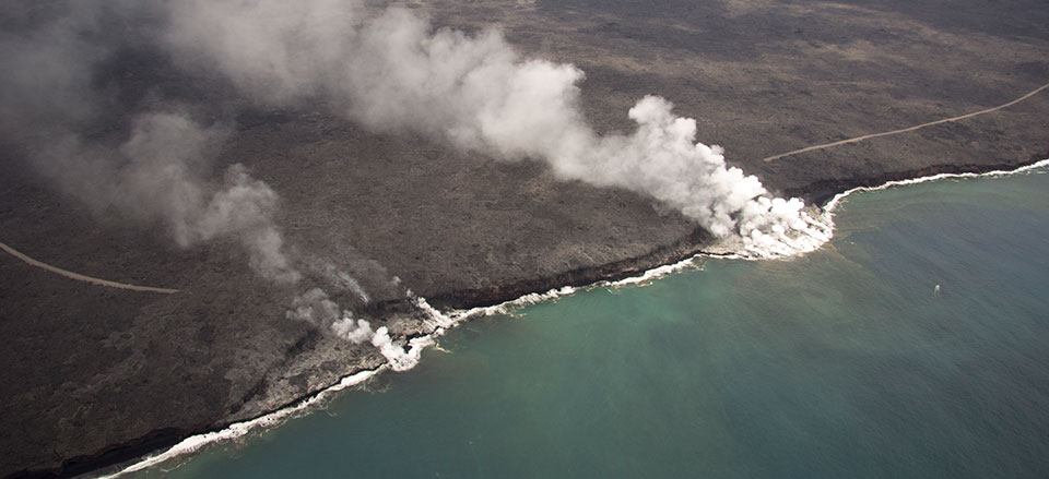 Lava continues to flow into the ocean at Kamokuna, with two main entry areas, both forming lava deltas. The eastern lava delta is the larger of the two, and today, a broad span of small lava streams entering the sea was creating a wide ocean entry plume.