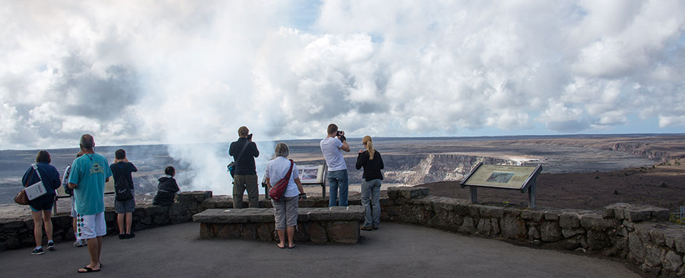 Visitors view the volcanic plume from Halema'uma'u
