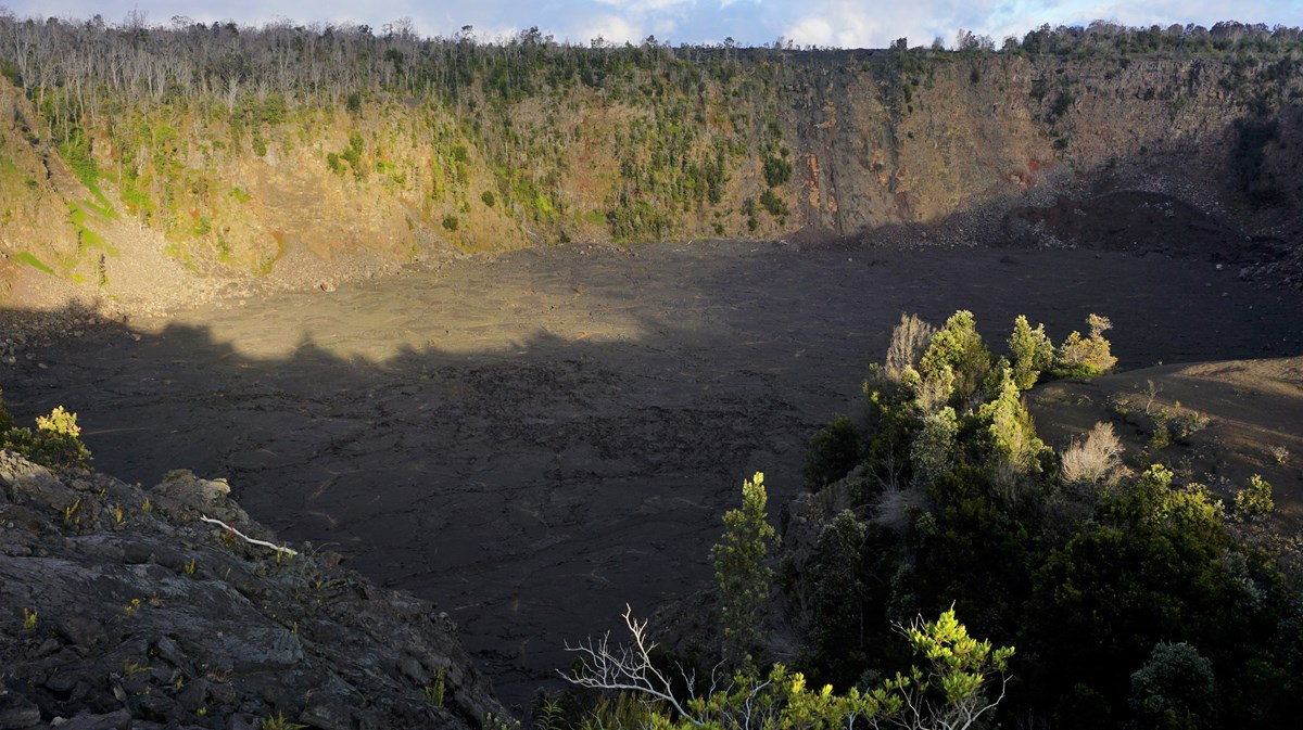 Sunset casting shadows on a volcanic crater