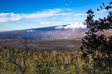 Volcanic caldera with trees in the foreground
