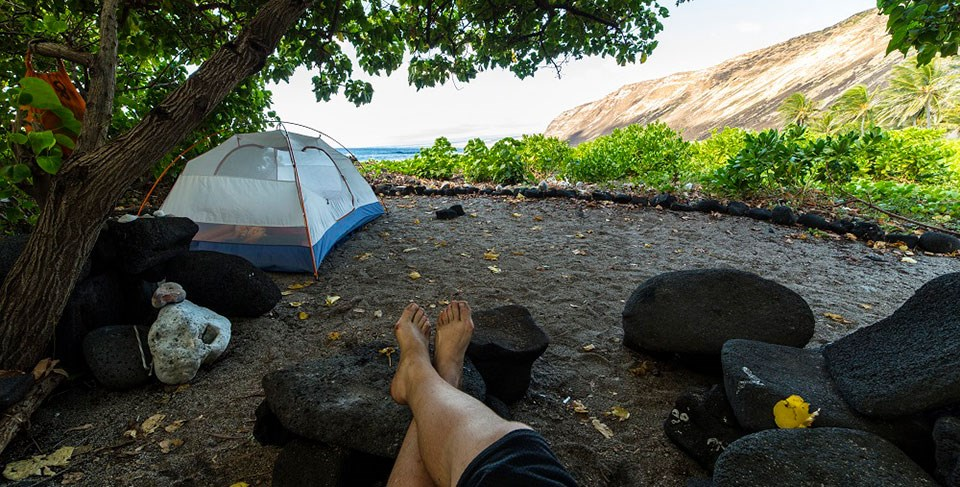 A camper enjoys the shade at Halapē