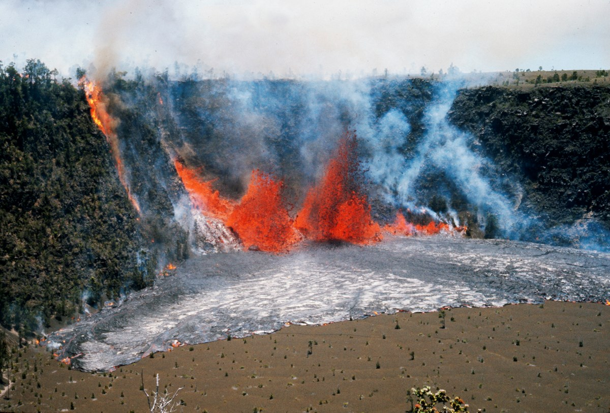 Lava fountaining from a fissure in the wall of a crater