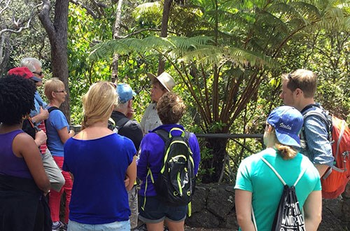 Volunteer Charlene leads an interpretive hike at Nāhuku (Thurston Lava Tube)