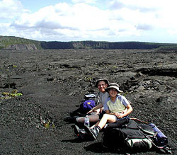Visitors enjoy the beauty of the lava landscape near Makaopuhi Crater
