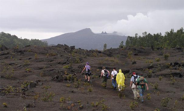 Hikers on the Nāpau Trail with Pu'u 'Ō'ō in the distance