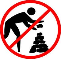 A graphic of a no symbol over a person stacking rocks