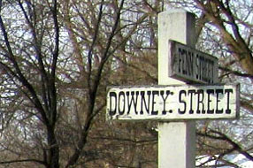 A painted wooden sign marks the intersection of Downey and Penn Streets.