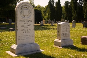 Two white headstones mark the graves of Jesse and Hulda Hoover.