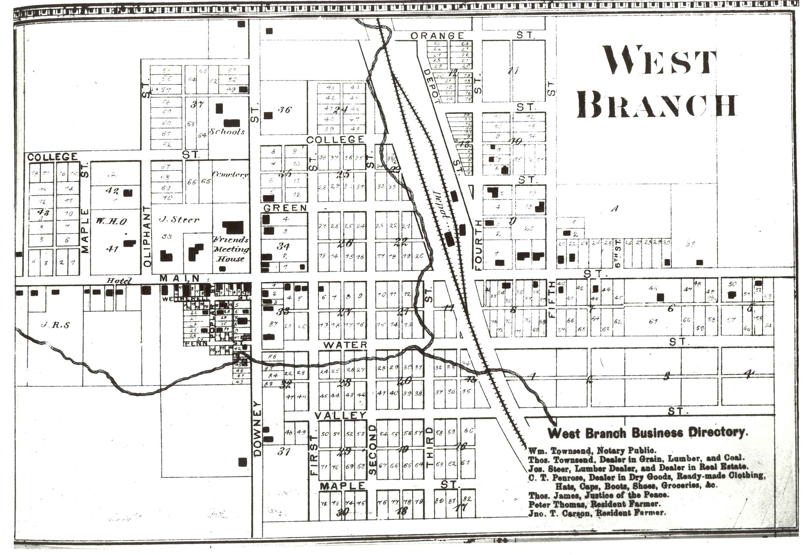 A black and white map drawing depicts a small town with a railroad.