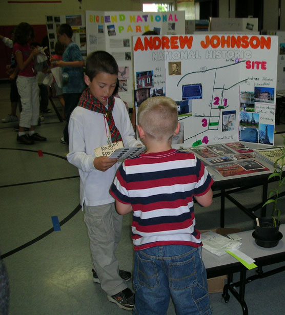 Elementary school students with national park displays.