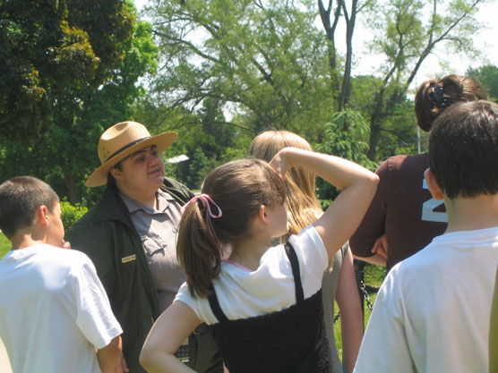 Park ranger leading an outdoor walking tour.