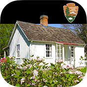 Icon for a mobile app shows a white cottage and bush of pink flowers.