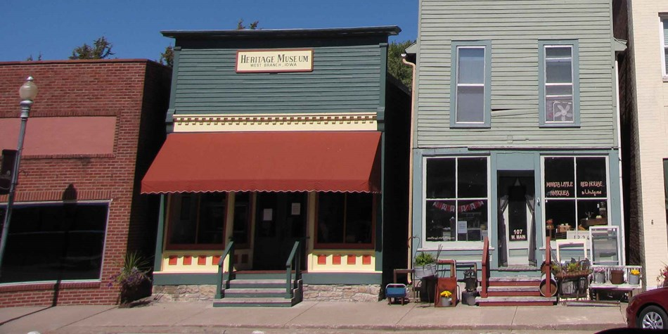 Restored wooden storefronts line a small town downtown street.