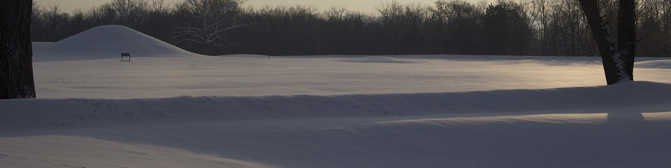 A fresh blanket of snow carpets the grounds at Mound City Group