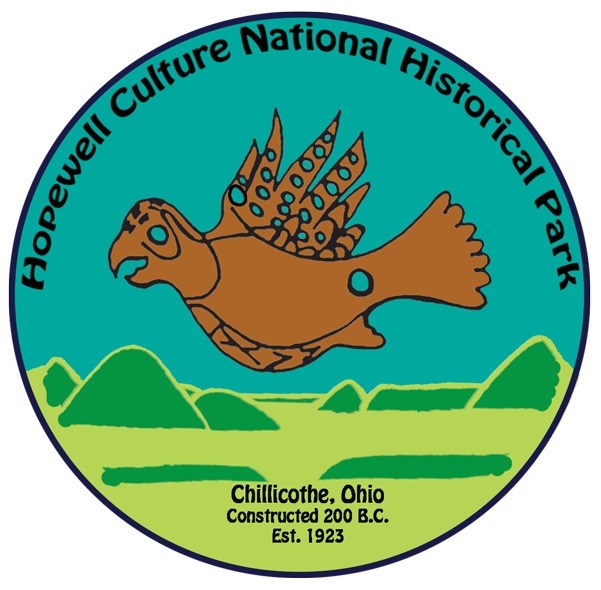 Park logo showing caricatures of copper bird and mounds