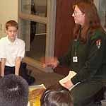 A ranger interacting with school kids