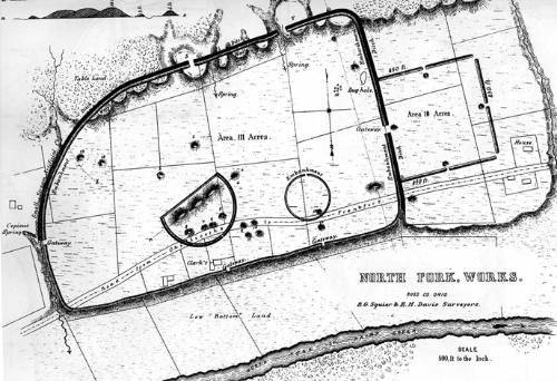 A black and white aerial view of an earthworks complex on a map