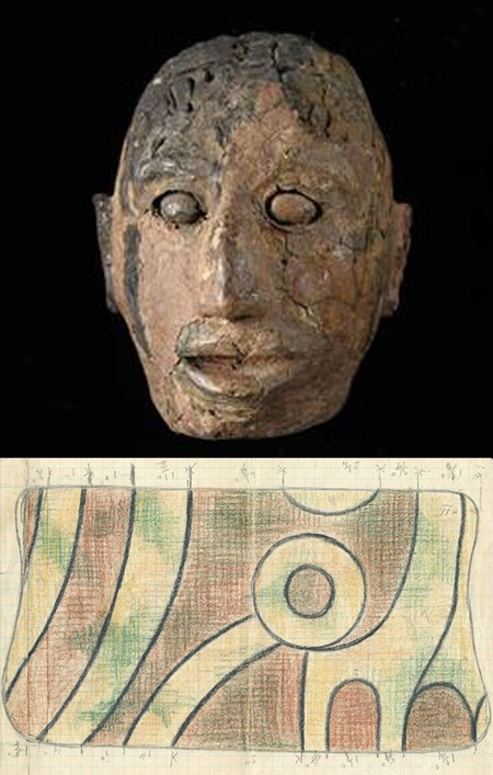 A stone effigy head and a drawing of a pattern on cloth