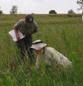 A volunteer helps national park staff inventory grassland species. Photo from NPS Heartland Network.