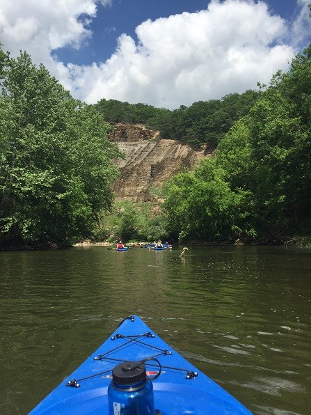 Kayakers floating down the Paint Creek