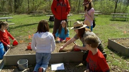Junior archeologists learn from a park ranger at Junior Archeology Day!