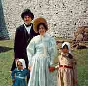 A family dressed in the finest 1830 attire.
