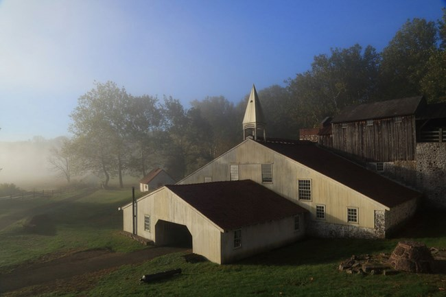 The Cast House surrounded by fog