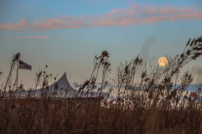 The full moon rises over the Heritage Center at Homestead National Monument