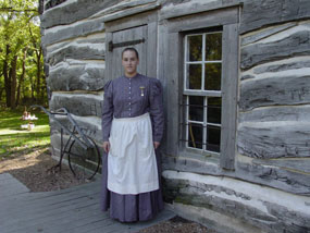 Woman in front of Cabin