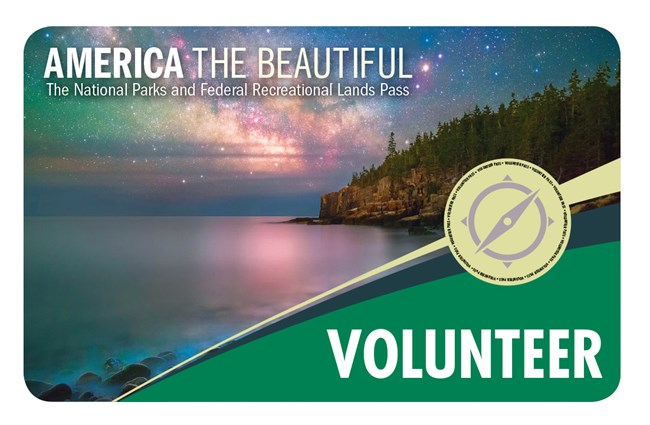 Front of Volunteer Pass. Photo shows a starry sky over a lake with a tree-covered island on the right.