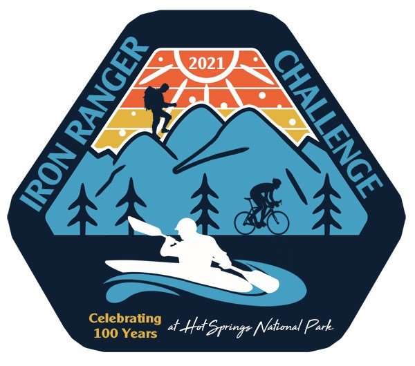 """Iron Ranger Challenge, Celebrating 100 years at Hot Springs National Park"" surrounds a hexagonal silhouette of mountains and trees with a hiker, biker, and paddler."