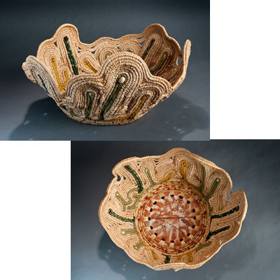 side view and top view of basket. Center is ceramic base of rust and clay color. Woven seagrass primarily natural color with areas of green extending upward.